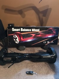 Black self balancing board with box and remote Howell, 07731