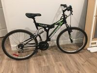 Black and green full suspension mountain bike