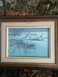 brown wooden framed painting of two wolves on snow Saint Andrews West, K0C 2A0