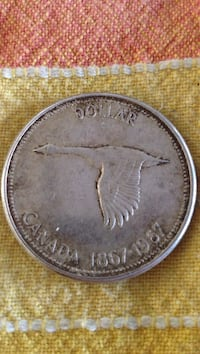 1867-1967 silver-colored Canadian dollar coin Toronto, M9P 1N7