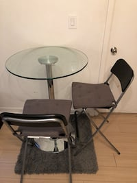 Glass kitchen table (spins) $225 Toronto, M5V