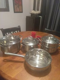 four stainless steel cooking pots Spring Valley, 91977