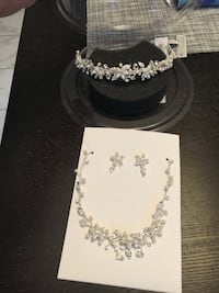 Never used Swarovski crystal necklace, earrings, and head piece. Gainesville, 20155