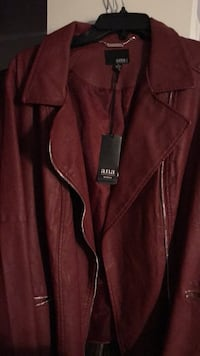 Burgundy faux leather 1x and 2x available. ANA brand, orig $150 at JCPENNEY. Quality lined jacket fits just below waist. Biker style but built for ladies to wear with dress and boots or jeans or when riding your bike. Classy never worn. Brown is 3x. Black Amarillo, 79108