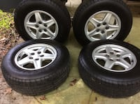 Gray 5-spoke car wheel with tire set   These tires came off a 88 S10 Chevy 237 mi