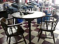 round black wooden table with four chairs dining set Bryan, 77808