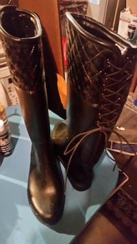 pair of black leather boots null