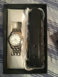 Silver link white analog watch and black leather belt