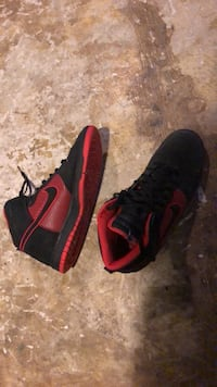 pair of black-and-red Nike basketball shoes 1951 km