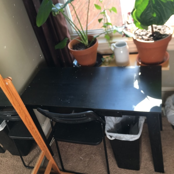Black wooden desk with foldable chair