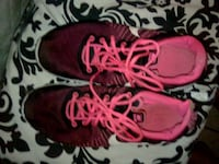pair of red Nike running shoes Bakersfield, 93307