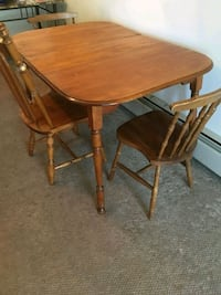 brown wooden table with three chairs Halifax, B3M 2N7