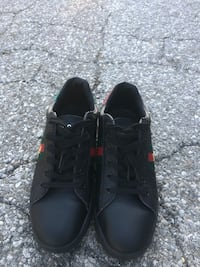 pair of black low-top sneakers Youngstown, 44502