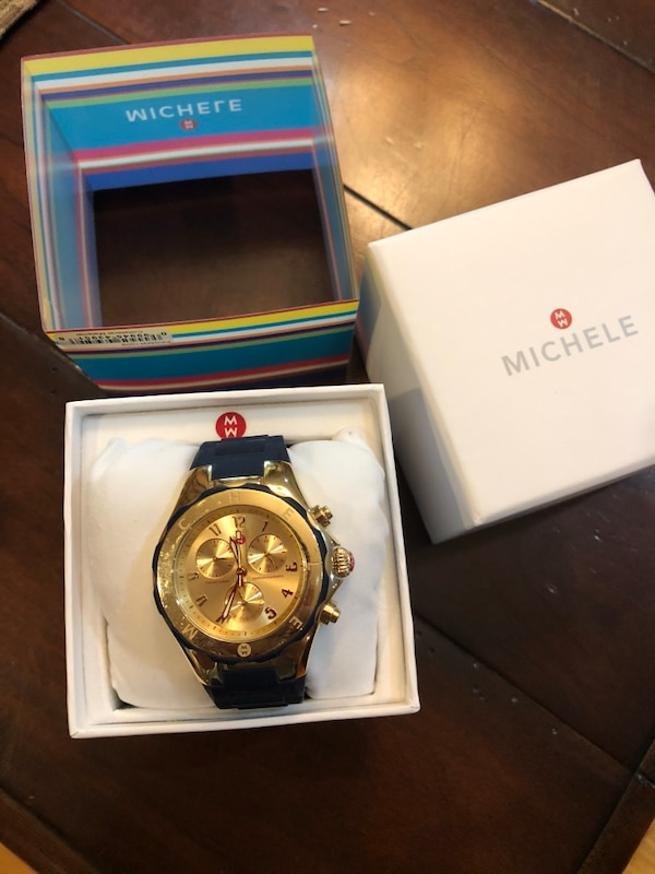 round gold chronograph watch with link bracelet