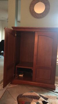 brown wooden cabinet with shelf 8 km