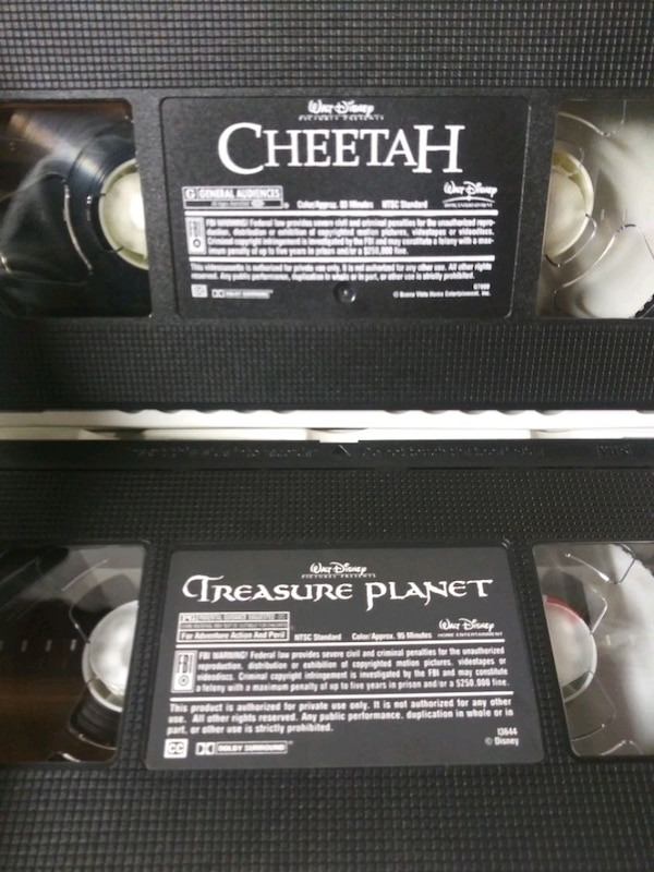 Treasure Planet and Cheetah vhs tapes 3d2a676e-aaea-44c2-8679-8a3794256bf6