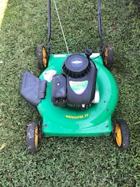 green and black Weed Eater push mower Rogers