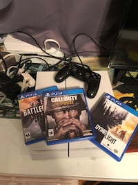 Sony PS4 console with controller and game cases Murrieta, 92562