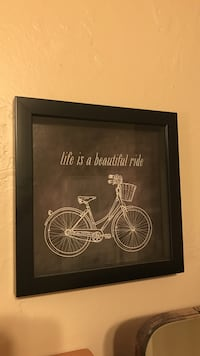 Black wooden framed step-through bicycle painting