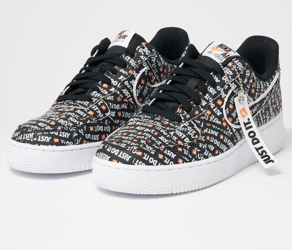 Pair of Nike Air Force premium just do it shoes
