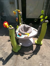 baby's green and white jumperoo 646 mi