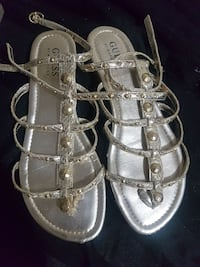 women's pair gold Guess gladiator sandals