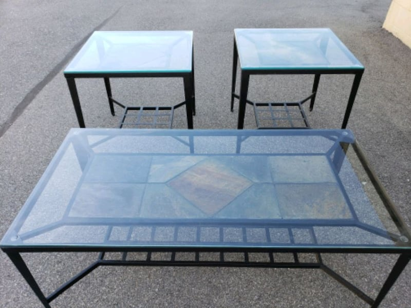 Metal and glass coffee table and 2 end tables.   22a24453-be6b-40b9-8a27-f53c6b702035