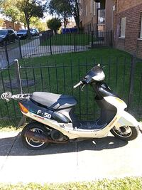 white and black motor scooter 47 km