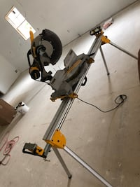 A 12in dewalt miter saw with stand Macomb, 48044