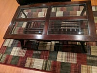 brown wooden framed glass top coffee table 533 km