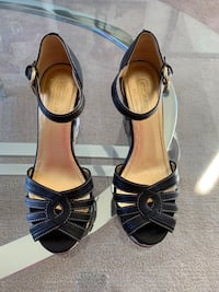 pair of black leather open toe ankle strap heels