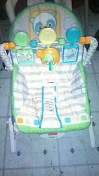 baby's white, green, and yellow bouncer