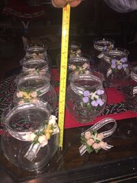 11 clear glass jar 6 pink flowers 5 purple flowers Quinlan, 75474