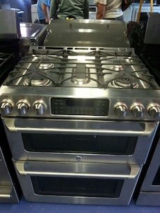 #1464 Brand New GE Double gas stove