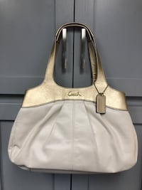 Leather Coach Purse with Gold Metalic Trim, in excellent condition. Myersville, 21773
