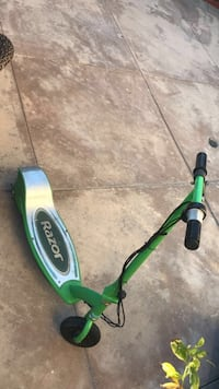 green and gray Razor electric scooter