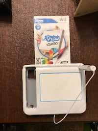 white and blue Nintendo Wii console with controller