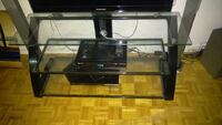 black glass top TV stand + sound system