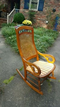 brown wooden rocking chair with brown cushion 107 mi