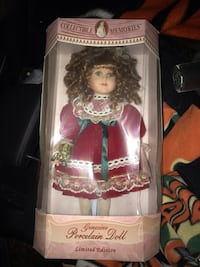 Porcelain doll wearing red and white dress. Limited edition Glen Burnie, 21060
