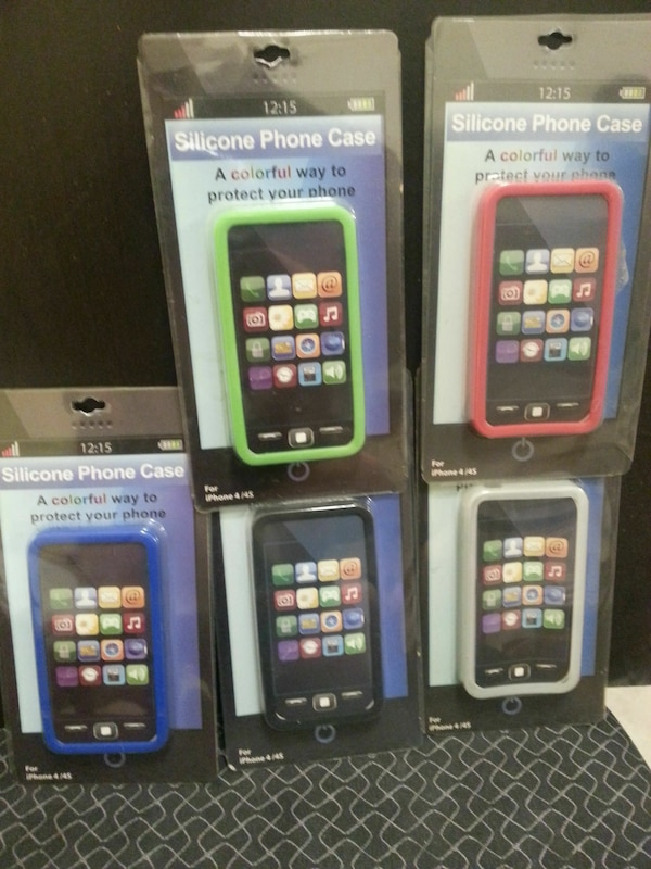 four assorted color Samsung Galaxy S7 Edge in boxes