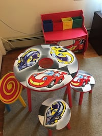 Toddler's round black multicolored wooden table with chairs set and toy box