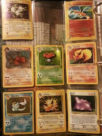 eight assorted Pokemon trading cards