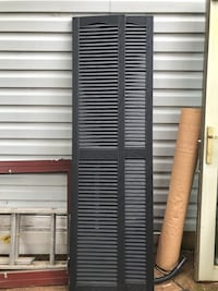 two black wooden louver doors 46 km