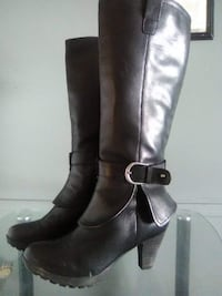 pair of black leather knee-high boots 2471 km
