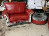 red fabric sofa chair with throw pillow
