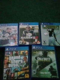 four assorted PS4 game cases