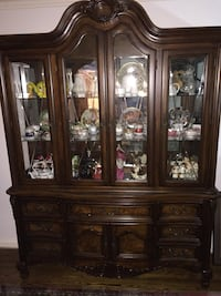 Brown wooden and glass china cabinet Toronto, M4A 1S5