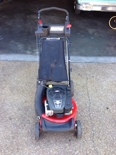 black and red push mower