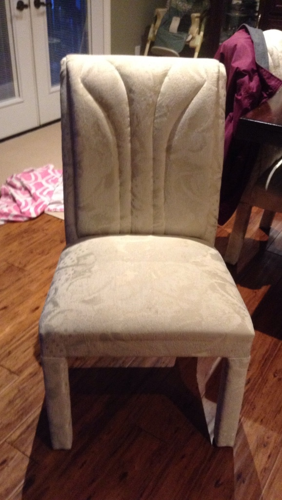 beige floral padded chair